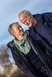 Happy senior couple elderly people together outdoor. In autumn winter Royalty Free Stock Photo