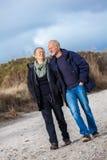 Happy senior couple elderly people together outdoor. In autumn winter Stock Photos