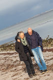 Happy senior couple elderly people together. Outdoor in autumn winter Royalty Free Stock Images