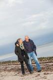 Happy senior couple elderly people together. Outdoor in autumn winter Stock Photo