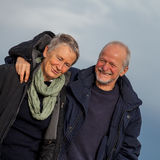 Happy senior couple elderly people together. Outdoor in autumn winter Royalty Free Stock Image