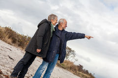 Happy senior couple elderly people together. Outdoor in autumn winter Stock Image