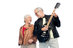 Happy senior couple with electric guitar Stock Photo