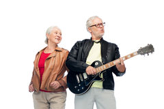 Happy senior couple with electric guitar Stock Images