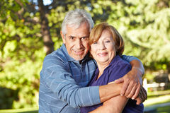 Happy senior couple embracing Stock Photos