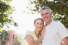 Happy senior couple embracing in the city Stock Photos