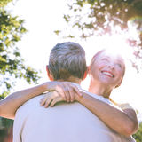 Happy senior couple embracing in the city Royalty Free Stock Photo