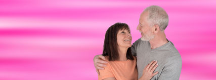 Happy senior couple embracing each other. On blurred background Royalty Free Stock Photos