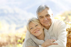 Happy senior couple embracing royalty free stock photos