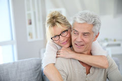 Happy senior couple embracing at home Royalty Free Stock Images