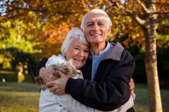 Happy senior couple embracing at park Royalty Free Stock Images