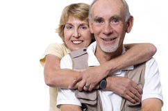 Happy senior couple embracing on white Stock Photo