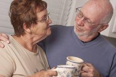Happy Senior Couple Enjoying Coffee Royalty Free Stock Photography