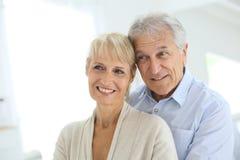 Happy senior couple enjoying their home Stock Image