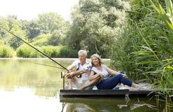 Happy senior couple fishing Stock Photography