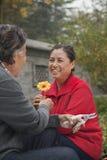 Happy Senior couple with flower royalty free stock photos