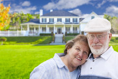 Happy Senior Couple in Front of House Royalty Free Stock Image
