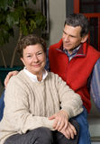 Happy Senior Couple on Front Porch Stock Photography