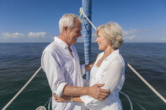 Happy Senior Couple On Front of a Sail Boat Royalty Free Stock Image