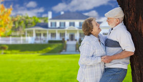 Happy Senior Couple in Front Yard of House. Happy Senior Couple in the Front Yard of Their House Royalty Free Stock Photography