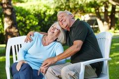 Happy senior couple in a garden royalty free stock photos