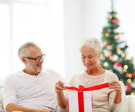 Happy senior couple with gift box at home Royalty Free Stock Photography