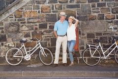 Happy senior couple going for a bike ride in the city Royalty Free Stock Photos
