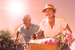 Happy senior couple going for a bike ride in the city Royalty Free Stock Images