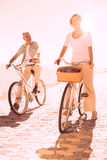 Happy senior couple going for a bike ride Royalty Free Stock Image