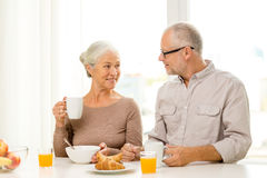 Happy senior couple having breakfast at home Royalty Free Stock Images