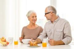 Happy senior couple having breakfast at home Stock Photography