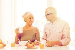 Happy senior couple having breakfast at home Stock Image