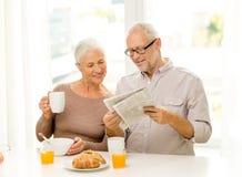 Happy senior couple having breakfast at home Royalty Free Stock Photography