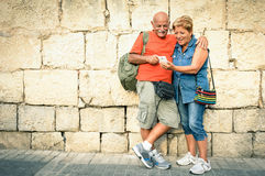 Happy senior couple having fun with a modern smartphone Stock Photo