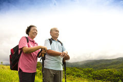 Happy senior couple hiking on the mountain royalty free stock images