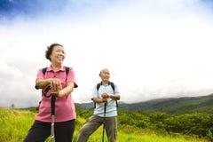 Happy senior couple hiking on the mountain royalty free stock photos