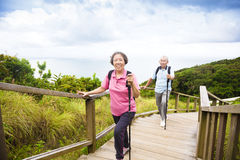 Happy senior couple hiking on the mountain park Royalty Free Stock Photo