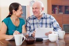 Happy senior couple holding  documents Stock Photo