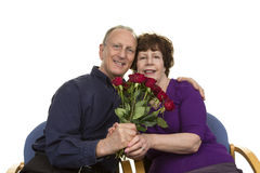 Happy Senior Couple Holding Flower Bouquet Royalty Free Stock Photo