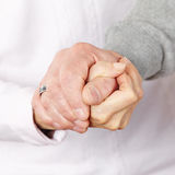 Happy senior couple holding hands Stock Image