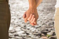 Happy senior couple holding hands Stock Photos
