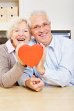 Happy senior couple holding a heart Stock Photos