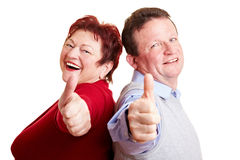 Happy senior couple holding thumbs Royalty Free Stock Photos