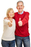 Happy senior couple holding thumbs up Stock Photos