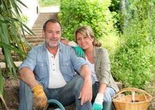 Happy senior couple at home garden Royalty Free Stock Photo