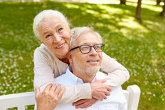 Happy senior couple hugging in city park. Old age, relationship and people concept - happy senior couple hugging in city park Stock Photos