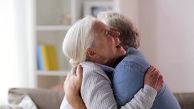 Happy senior couple hugging at home stock footage