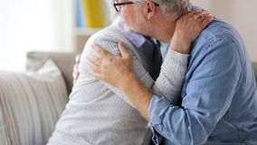 Happy senior couple hugging at home stock video footage