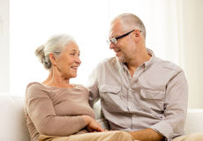Happy senior couple hugging on sofa at home Royalty Free Stock Photography