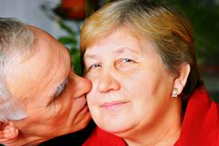 Happy senior couple kissing Stock Photos